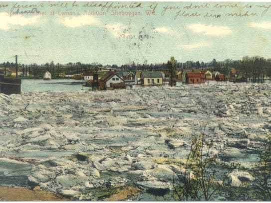 Postcard showing the Sheboygan River backed up with