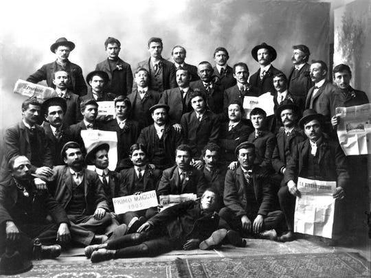 In 1905, participants demonstrate their allegiance to political factions by holding representative newspapers during the Primo Maggio celebration in Barre.