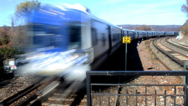 A southbound Metro-North train rounds a bend at Spuyten Duyvil in the Bronx as it approaches the station Nov. 25. Four years earler, a southbound train derailed coming around the same bend, killing four passengers.
