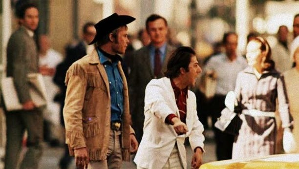 """""""Hey! I'm walkin' here!""""  Jon Voight (left) and Dustin Hoffman play an unlikely pair of hustlers in """"Midnight Cowboy."""""""