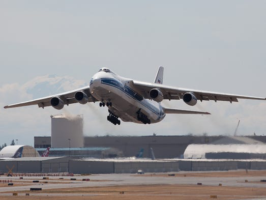 A giant Antonov 124 cargo jet takes off from Paine