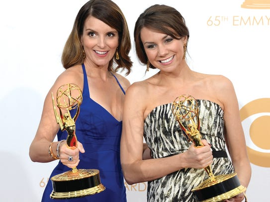 Actress-writer Tina Fey (left) and writer Tracey Wigfield,