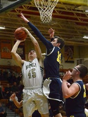 Howell's Nick Tholen takes a shot while Hartland's
