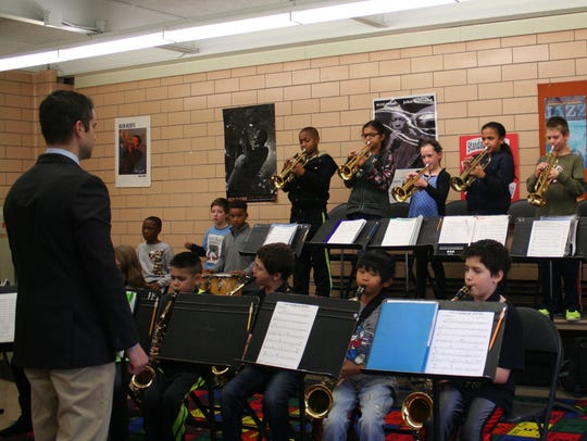 Robert Bickford rehearses students in preparation for
