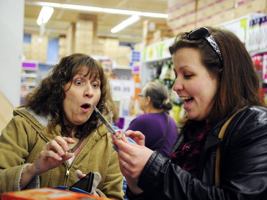 Fran Monbray of West York and her daughter Stefanie Moyar of Spring Garden Township react after finding a  figurine for less at the West Manchester Township Toys R Us on Thanksgiving night.
