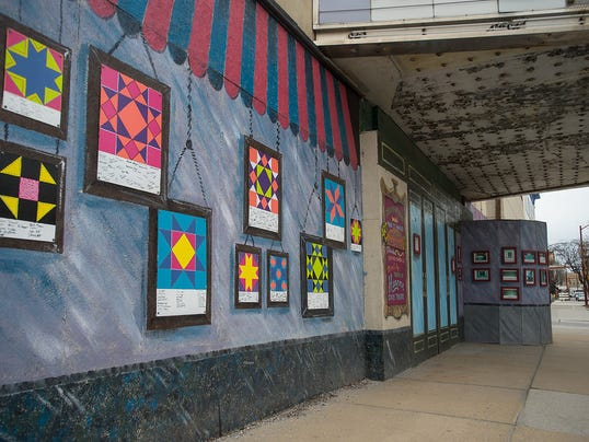 About 420 students and 40 faculty members from the Hanover Public School District helped with a schoolwide project that highlights the unique designs of traditional Amish quilts. The art hangs outside the theater in Center Square. (Clare Becker -- The Evening Sun)