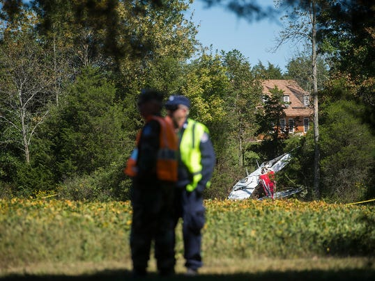 Members of the York Composite Squadron, part of the Civil Air Patrol, stand guard Sept. 20, the day after a single-engine plane crashed into a soybean field in Cumberland Township.