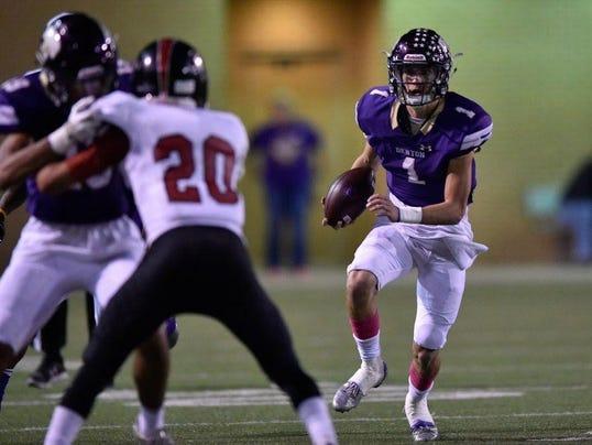Denton sophomore quarterback Landry Kinne 1 rushes the ball against the Wichita