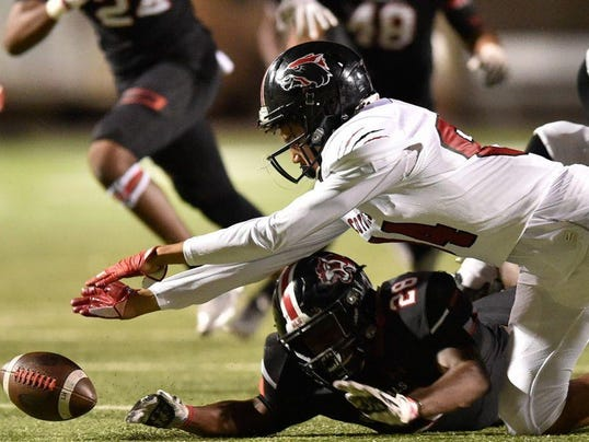 Braswell sophomore linebacker CJ Johnson 28 and Wichita Falls sophomore wide rec