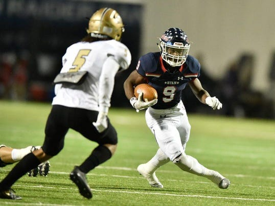 Ryan sophomore running back Emani Bailey 9 rushes the ball against the Rider def