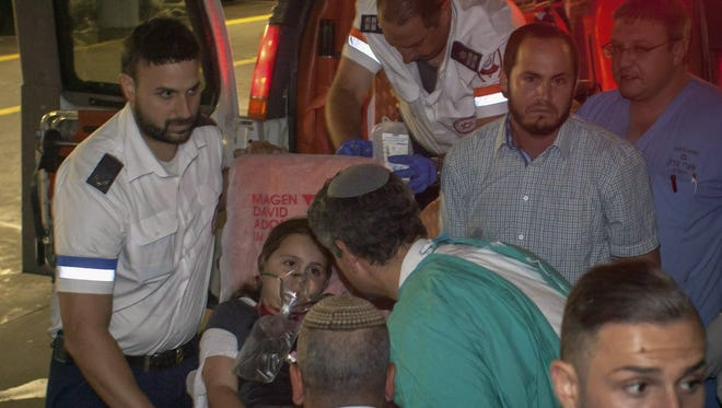 A nine year old Israeli girl is brought to a hospital in Jerusalem after being shot in Pasgot, a Jewsih settlement, near Ramallah, West Bank.