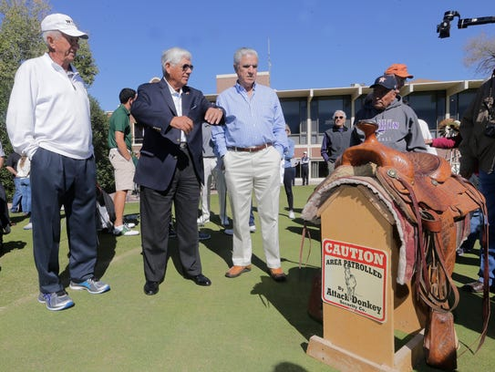 Former PGA golfer Lee Trevino shares some time with