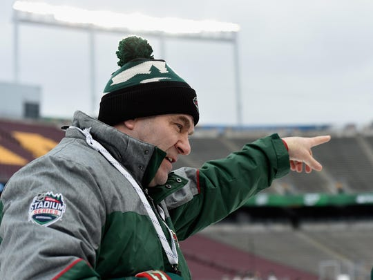 Interim head coach John Torchetti of the Minnesota Wild speaks to a player during practice day at the 2016 Coors Light Stadium Series on February 20 at TCF Bank Stadium in Minneapolis, Minnesota.