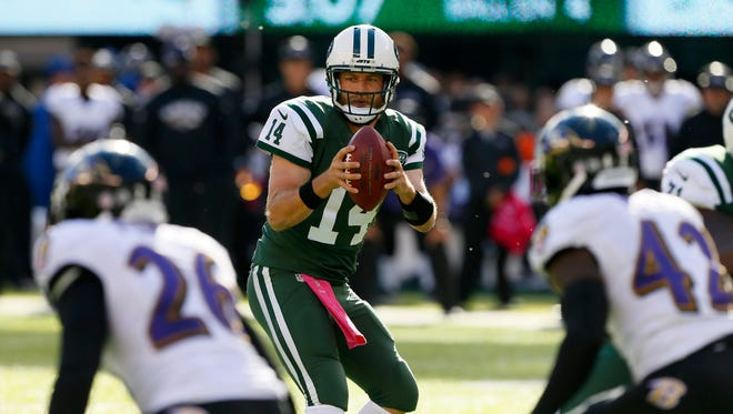 New York Jets quarterback Ryan Fitzpatrick (14) drops back to pass against Baltimore Ravens during second half at MetLife Stadium. The New York Jets defeated the Baltimore Ravens 24-16.