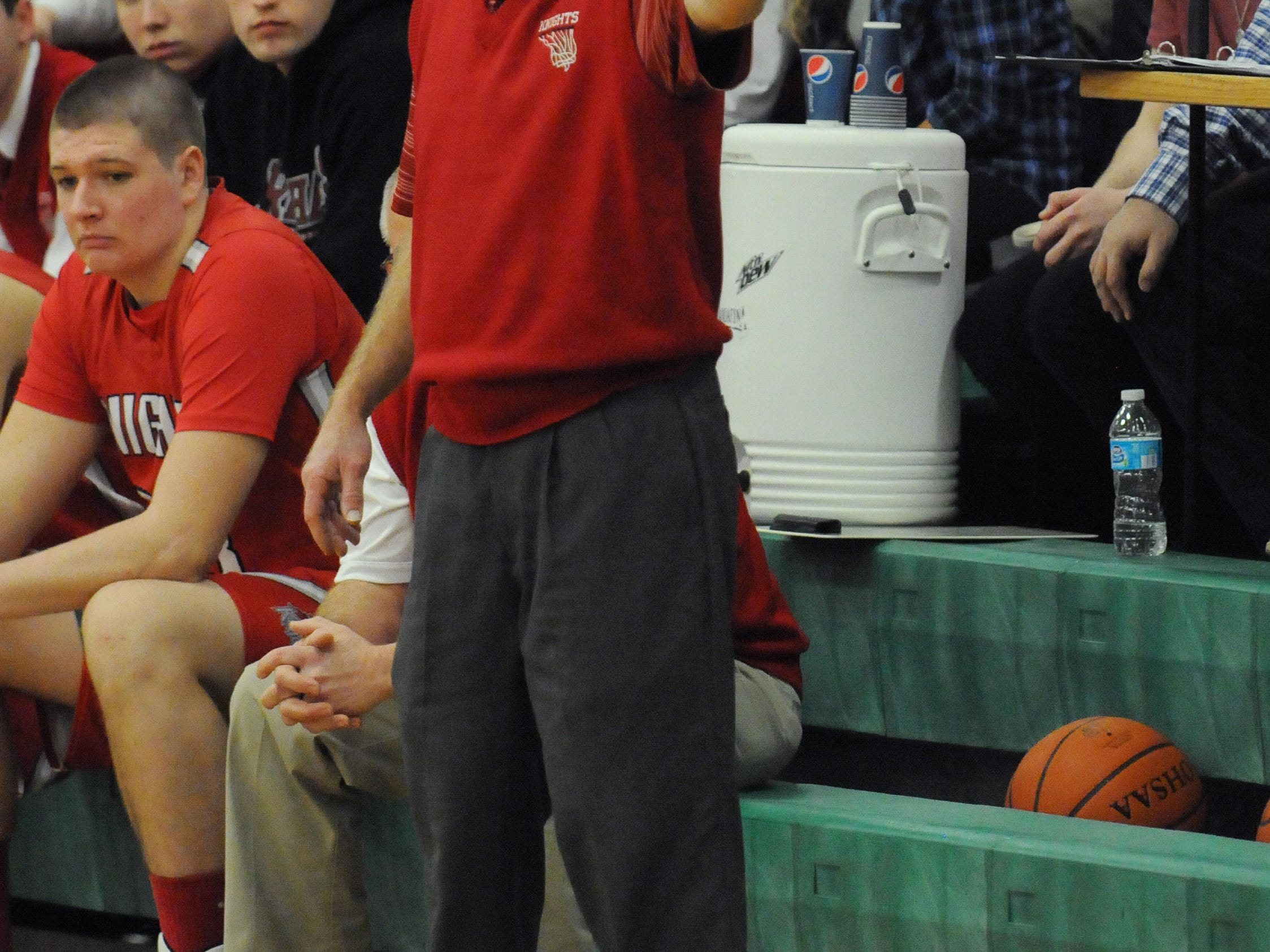Roger Hooper, Fairfield Christian Academy boys basketball coach, works the sidelines during the Knights' game against Fisher Catholic earlier this season. Hooper coached for 30 years at New Lexington before spending the past 13 with Fairfield Christian.