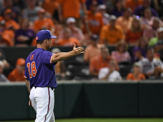 Clemson head coach Monte Lee (18) questions an umpire during the Tiger's NCAA Clemson Regional game against Vanderbilt at Doug Kingsmore Stadium in Clemson Saturday, June 2, 2018.