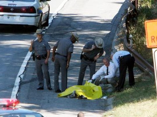 New York State Police investigate the scene on the side of the northbound Sprain Brook Parkway in Greenburgh on Sept. 3, 2005 where Angel Serbay's body was found.