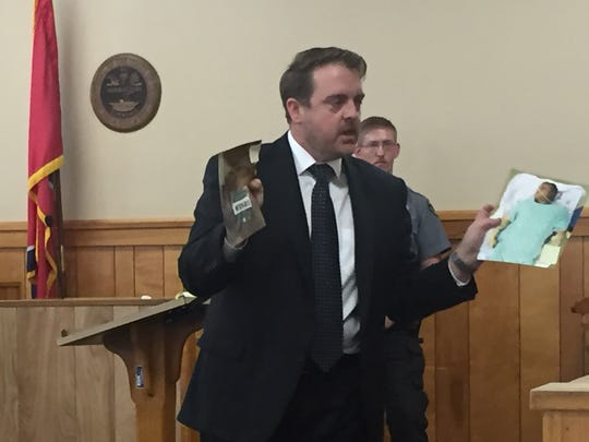 District Attorney Ray Crouch shows photos of Seth Brabant to jury members to remind them of the shoelace tied around his neck when he was left on a remote Stewart County road in 2016.