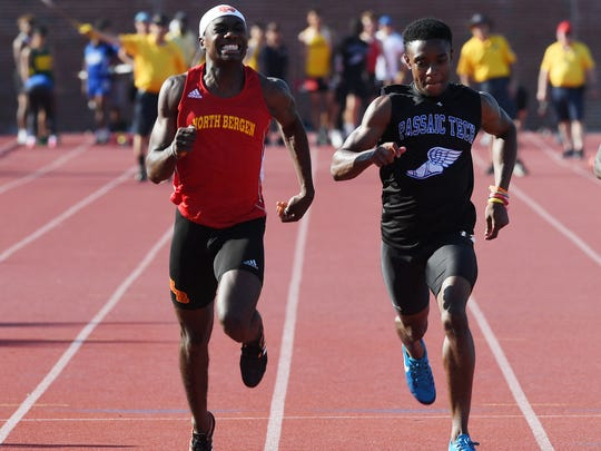 First day of State Sectional Group 1 and 4 Championships at Clifton High School on Friday, May 25, 2018. (left) Giano Roberts, of North Bergen, and Neimar Santouse, of Passaic Tech, in the boys 100M.