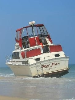 The Mel Rae, a Silverston cruising yacht, washed ashore in Long Beach Island, N.J. earlier this week. Police has been unable to identify to contact the owners.