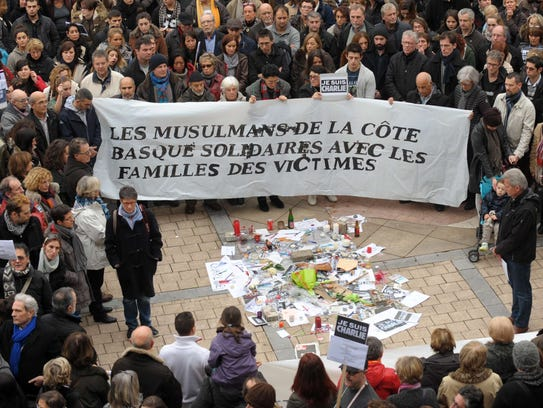 "People hold a banner, reading ""Muslims of the Basque"
