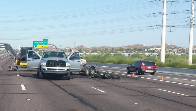 A motorcyclist was injured after he was involved in a fiery wreck on Loop 202 with a silver Dodge on June 22, 2015.
