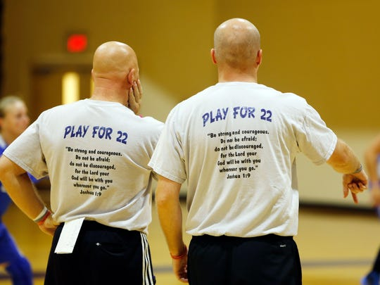"Mount head basketball coach Dan Benjamin, left, and assistant coach Jared Niesen wear shirts in Hill's honor that say ""Play for 22,"" which is Hill's jersey number. Hill has brain cancer and is not expected to live much longer.e on Nov. 2 in MSJ's opener at Cintas Center, which is sold out. Hill has brain cancer and is not expected to live much longer. The NCAA agreed to move up the game to ensure Hill so that she could play."