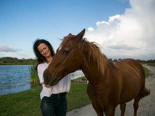 Dee Sieg with one of the farm's horses.