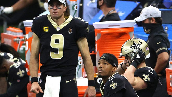 Drew Brees, left, and Jameis Winston of the New Orleans Saints look on from the sideline during their game against the San Francisco 49ers at Mercedes-Benz Superdome on Nov. 15, 2020 in New Orleans, La. Brees suffered multiple rib fractures and a collapsed lung during the game.