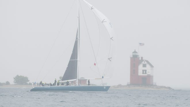 Evolution crosses the finish line at Mackinac Island traveling in the fog and rain Sunday, July 17, 2016. They are projected to place first place in Class A, Division I and Racing overall after finishing the Port Huron-to-Mackinac Island Sailboat Race with an uncorrected time of 28:10:31.