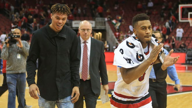 Louisville's Damion Lee and Trey Lewis walk towards the locker room after 79-47 win over Boston College Saturday afternoon at the KFC Yum! Center. Feb. 6, 2016