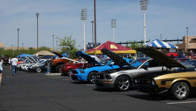 Vintage and modern cars, like these Ford Mustangs, are welcome at Jennabears Car Show and Family Fun Day in Peoria.