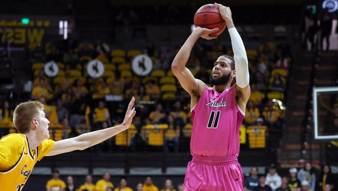 Nevada's Cody Martin puts up a shot over Wyoming defender Hayden Dalton during a double-overtime game last week in Laramie, Wyo. Wyoming won the game but Nevada remains the top team in our Mountain West power rankings.