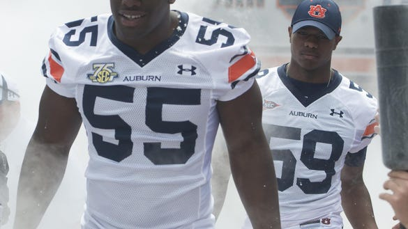 Auburn defensive linemen Carl Lawson and Raashed Kennion