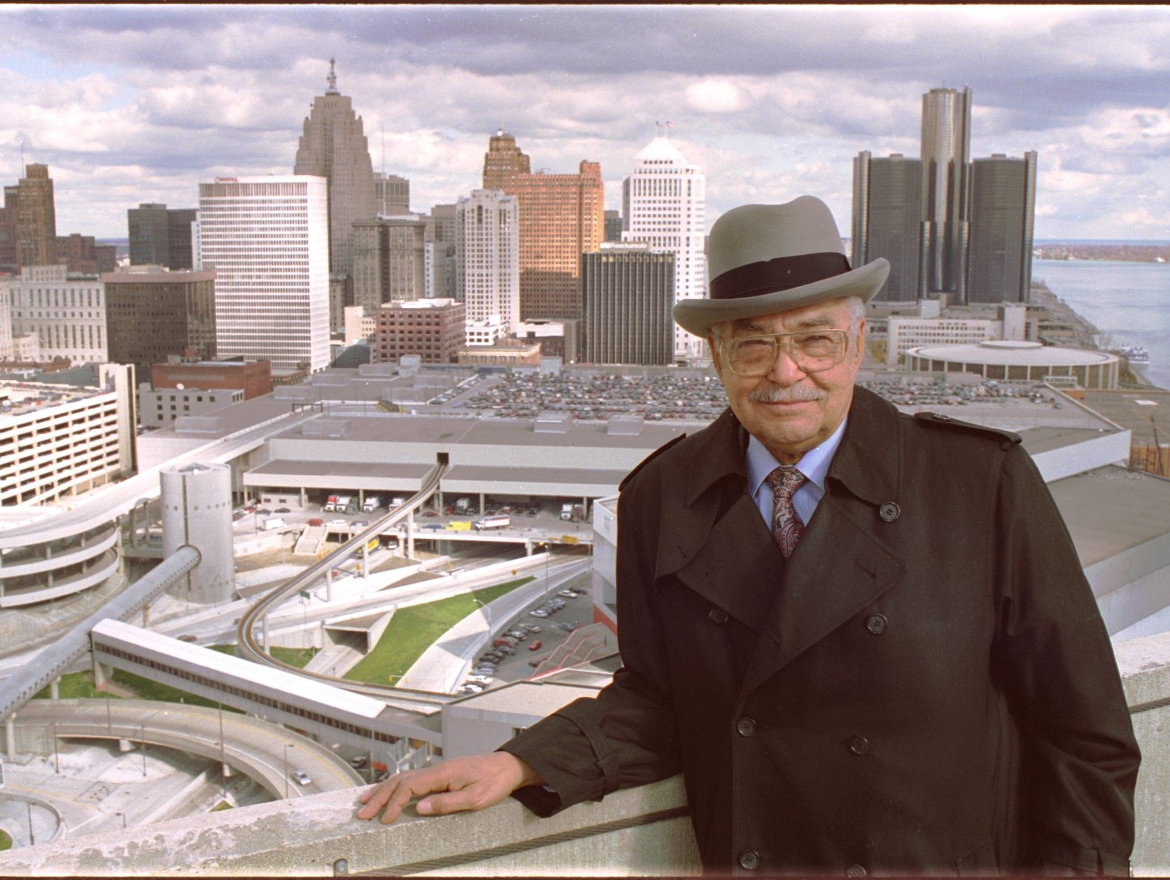 Detroit Mayor Coleman Young poses for a photo atop