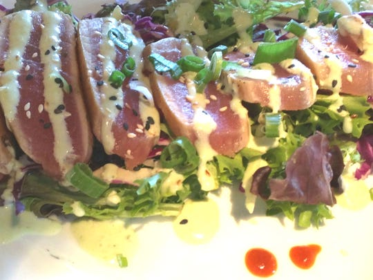 Chill and Grill's seared tuna salad with Asian slaw and a piquant cucumber-wasabi dressing.