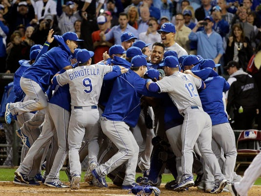Kansas City Royals' Nori Aoki, of Japan, left, jumps as he celebrates with teammates after the Royals defeated the Chicago White Sox 3-1 in a baseball game in Chicago on Friday, Sept. 26, 2014. (AP Photo/Nam Y. Huh)