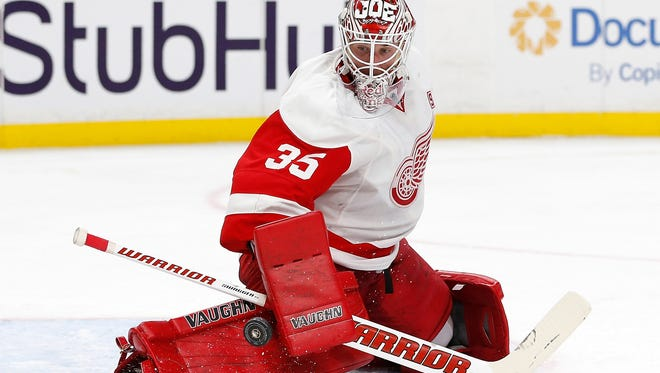 Red Wings goalie Jimmy Howard (35) makes a save against the Sabres during the second period of the Wings' 2-1 win in a shoot-out Wednesday in Buffalo, N.Y.