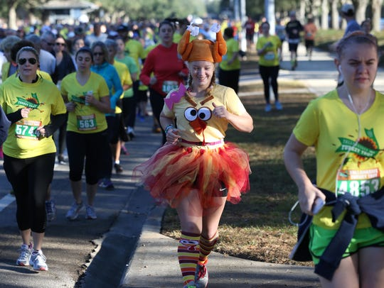 Runners, some on Thanksgiving themed costume, came