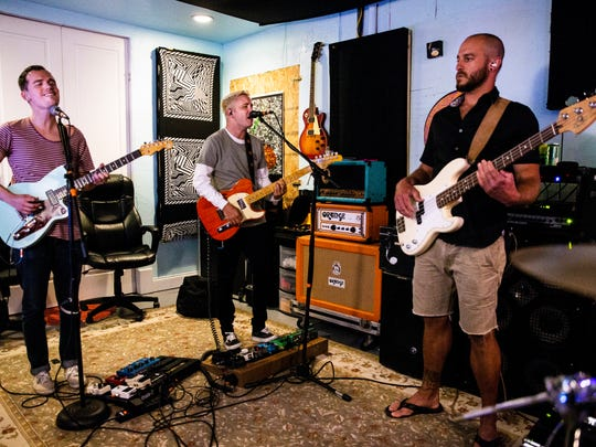 Vocalists and guitarists Brian Blount, from left, and Jake Rubinton perform alongside bassist Dan Springs during a Wilder Sons rehearsal in Bonita Springs on Tuesday, June 12, 2018.