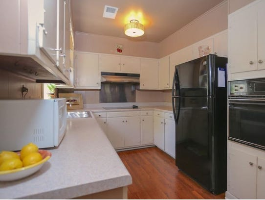 The home features a galley-style kitchen.