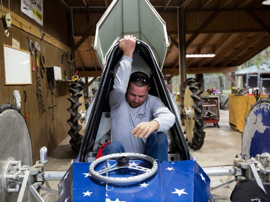 """Despite losing his left arm in an airboat accident eight months ago, Tyler Johns eases his way into his swamp buggy, The Patriot, at his parents' home Thursday, Jan. 25, 2017. Johns is preparing to compete in the first swamp buggy races of the season this weekend at Florida Sports Park. """"I'm more nervous of failure than anything,"""" Johns said. """"Not nervous about winning or losing. Just being able to go out there and do what I used to do. It's the proving grounds."""""""