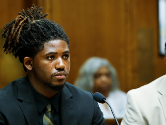 Former MSU football player Auston Robertson listens to 55th District Court  Judge Thomas Boyd   during his preliminary hearing on criminal sexual conduct charges Thursday morning, June 22, 2017, with his attorney David Rosenberg at his side.  [MATTHEW DAE SMITH/Lansing State Journal]