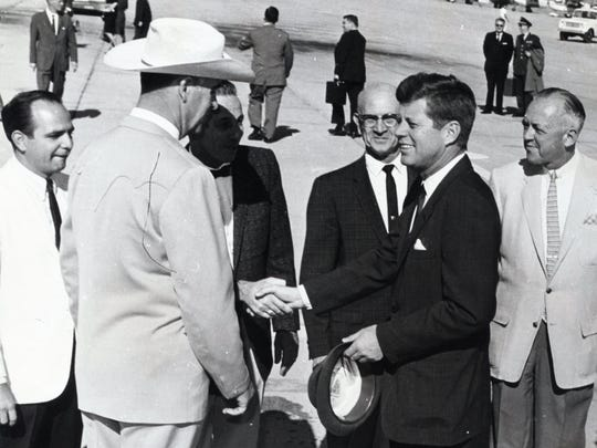 Mayor Frank Bogert greets Pres. John F. Kennedy at Palm Springs Airport with unidentified City officials.