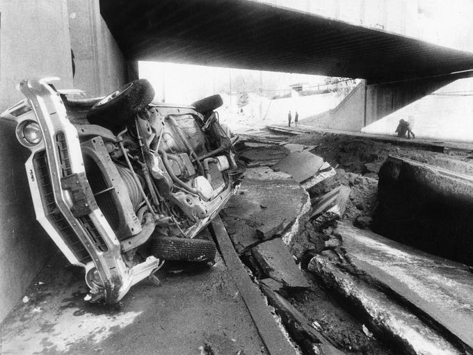 A car lays on its side at the underpass at 10th street,