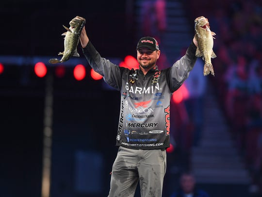 Jason Christie holds two of his fish during weigh in