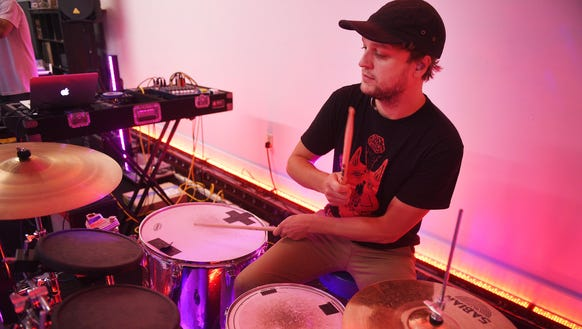 Soulcrate drummer and light technician Isaac Show rehearse