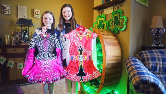 Rylie Brison, left, and Grace Swain, right, show their