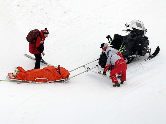 India Sherret, of Canada, is helped after crashing during the women's ski cross elimination round at Phoenix Snow Park at the 2018 Winter Olympics in Pyeongchang, South Korea, Friday, Feb. 23, 2018. (AP Photo/Kin Cheung)