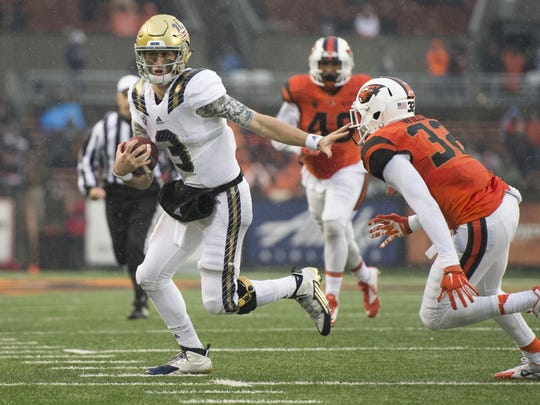 UCLA quarterback Josh Rosen (3) picks up a first down as he runs past Oregon State linebacker Jonathan Willis (32) during the second half of the Bruins' 41-0 win on Nov. 7 at Reser Stadium.